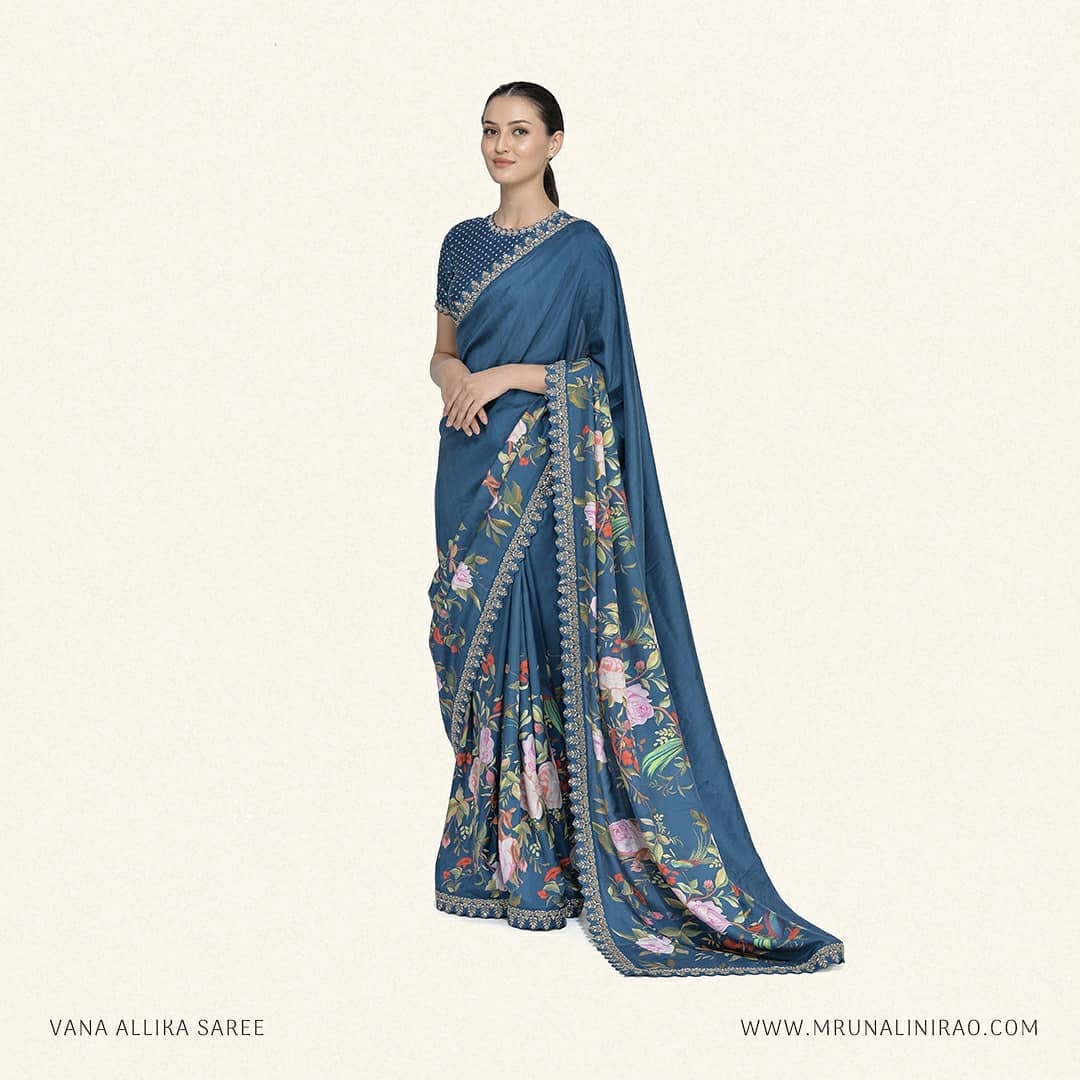 Make a floral statement this Eid in 'Vana Allika Saree'. It is crafted in pure silk with zardozi border and paired with jewel neck tara buta blouse. 2021-07-11