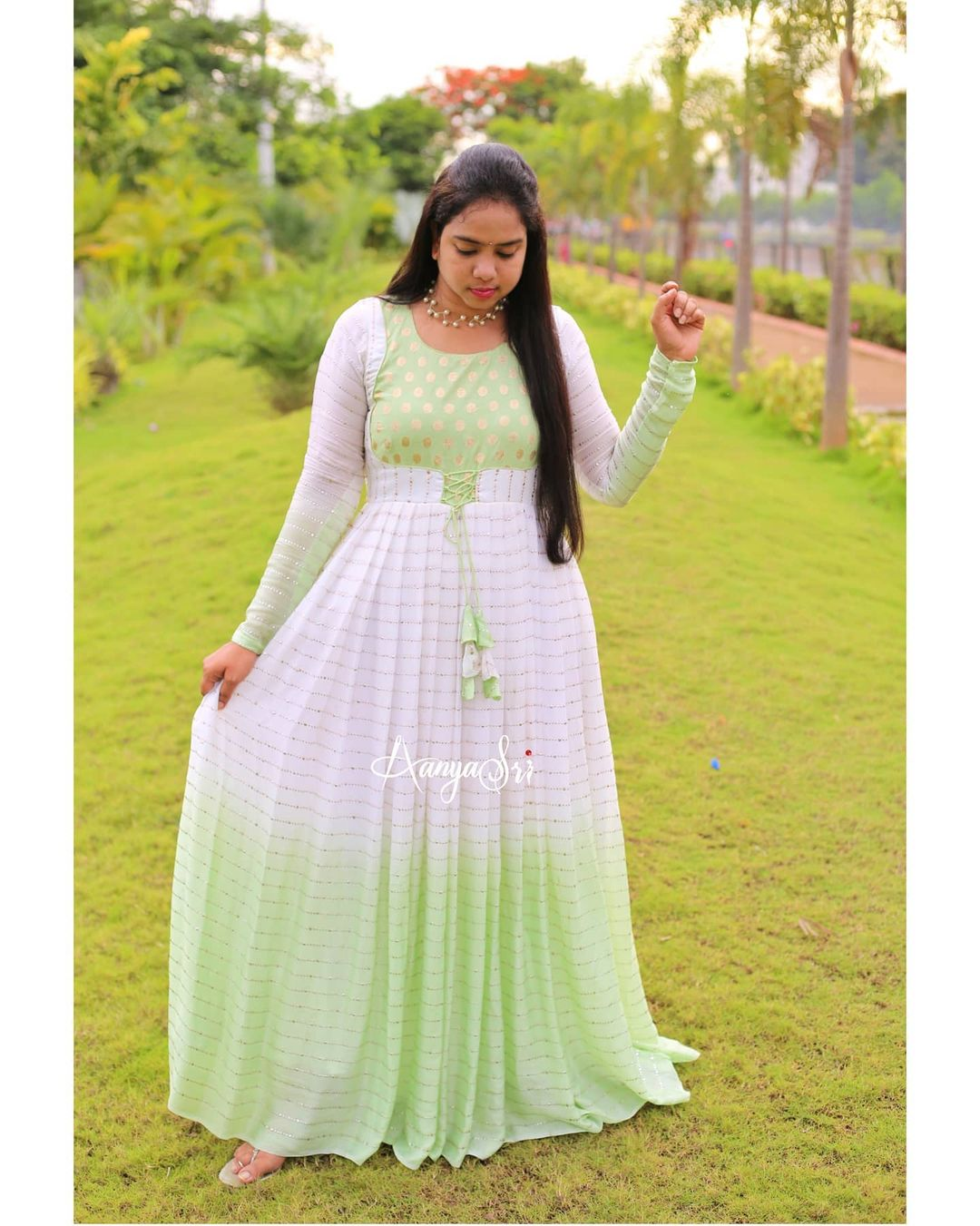 White and Green. Price : RS. 4200. White and green subtle shaded pastel long frock with a detailed neckline and self mukesh work allover the frock. 2021-07-11
