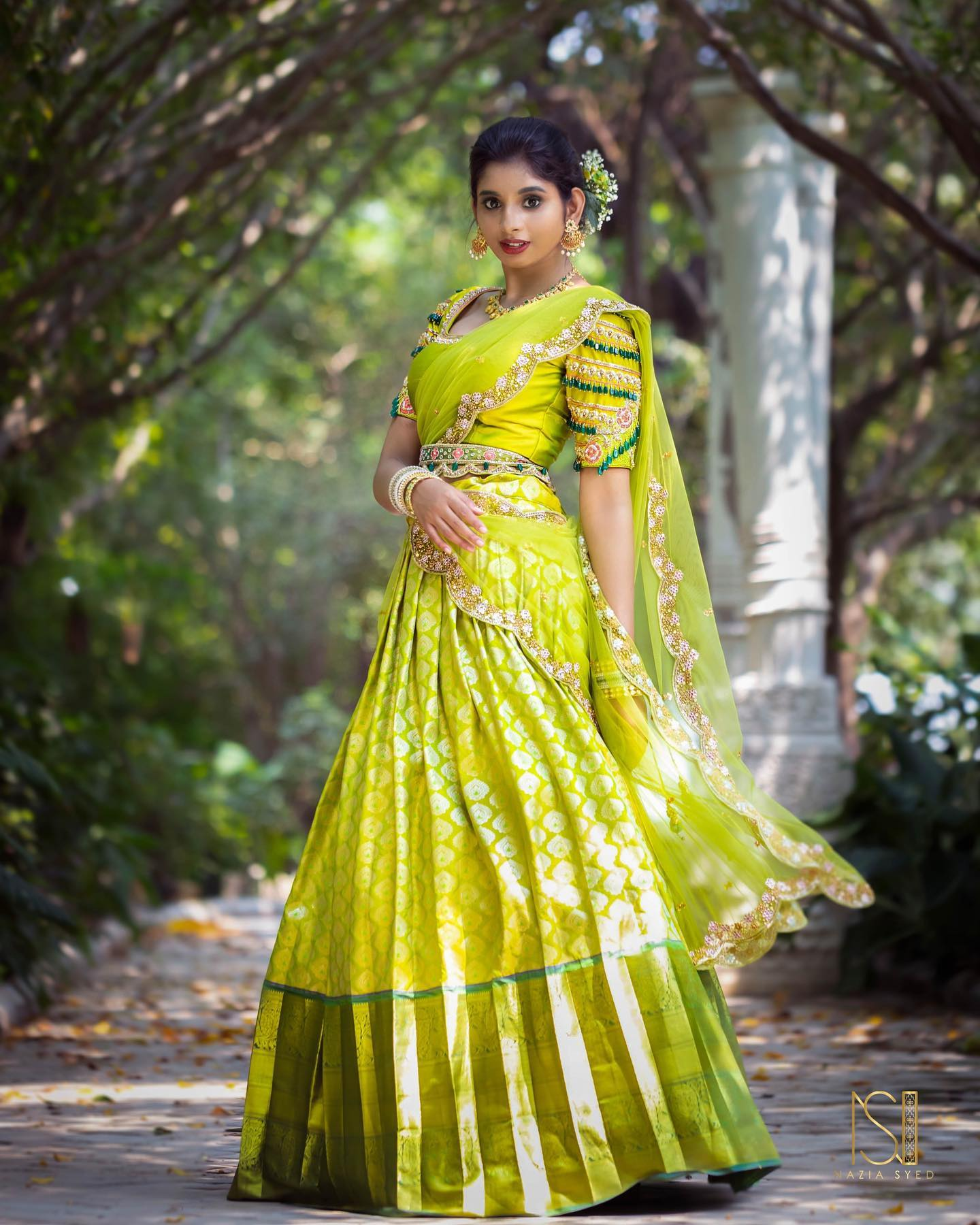 Stunning parrot green color pattu lehenga and blouse with net dupattta. Blouse with hand embroidery bead work.  2021-07-12