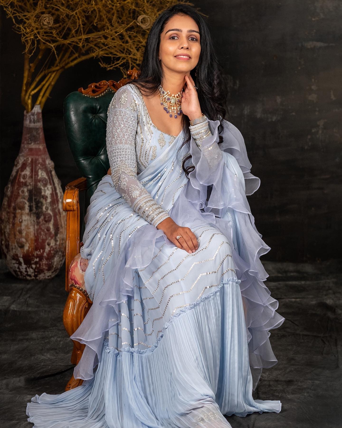Stunning ice blue color ruffle saree and full sleeve blouse with sequin hand embroidery work.  2021-07-13