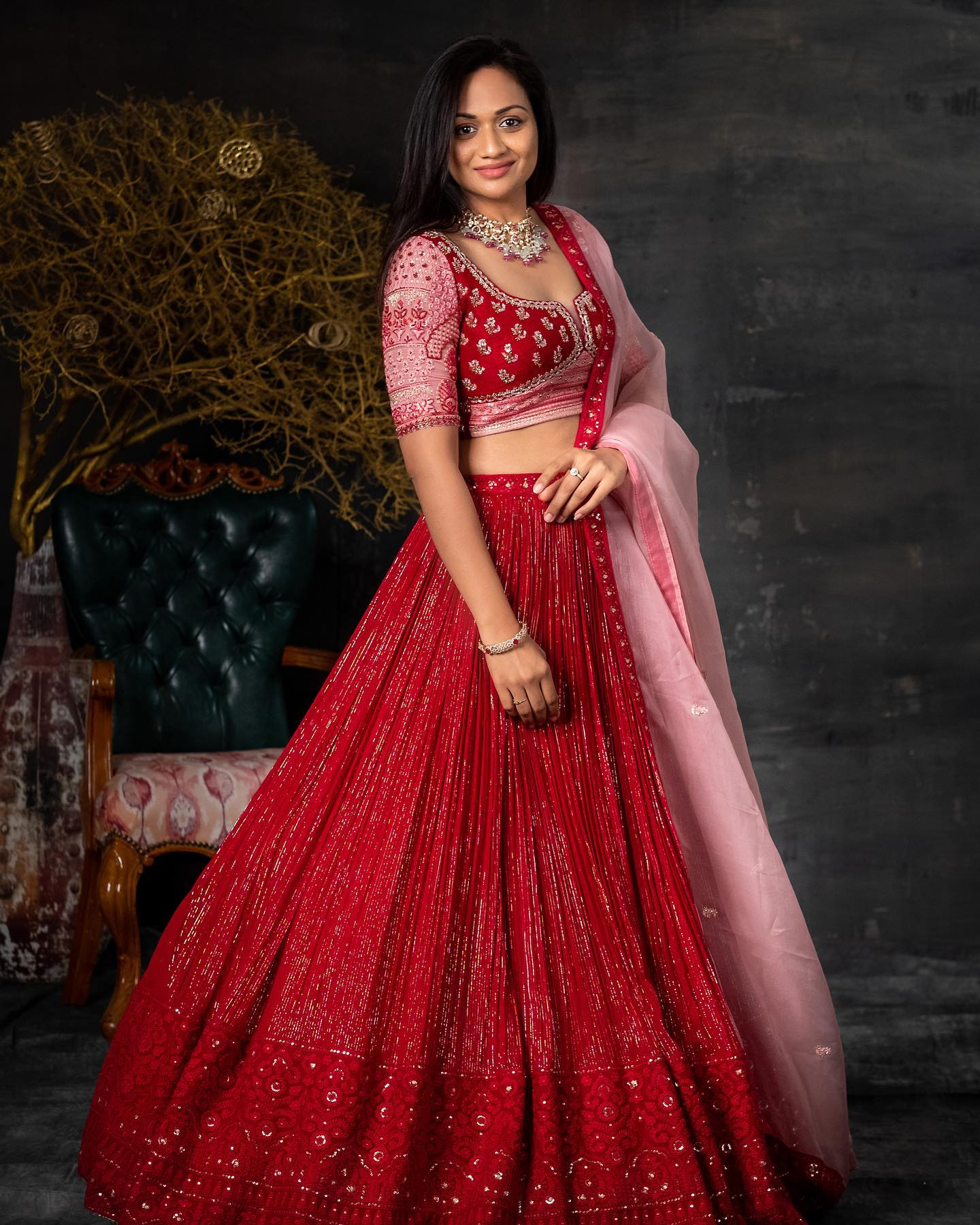 Pretty red color bridal lehenga and blouse with classy hand embroidery sequin work.  2021-07-13