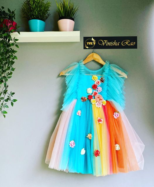A beautiful flowers on yoke and Pleated sleeves from shoulder to yoke teamed with multi color tulle from waist long frock for girls from the house of Vinisha rao designer studio !! Suitable for all kind of occasions !! .. . You can call us to order on Call : 9704994151. . Email - shopvinisharao@gmail.com 2021-07-14