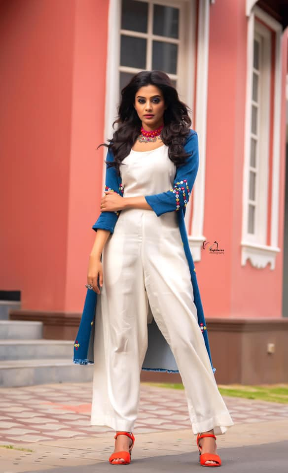 Beautiful actress Priyamani in white palazzo and top with blue color embroidery long over coat.   2021-07-14
