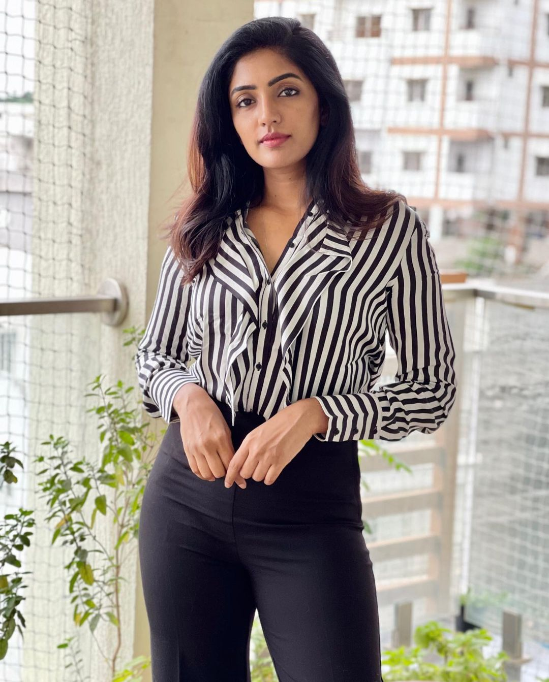 Stunning actress Eesha Rebba in striped shirt and bottom pants. 2021-07-14