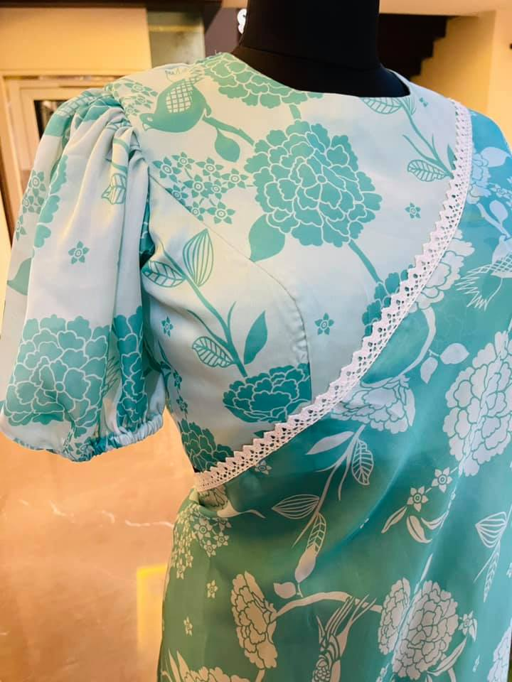 Beautiful satin georgette floral saree and blouse with bell sleeves. Price : 5500 INR. To order WhatsApp 7013728388. 2021-07-15