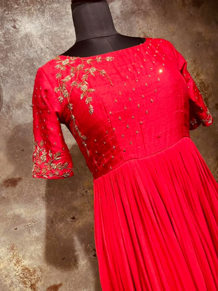Gorgeous tomato red color floor length long frock with creeper and floral hand embroidery stone and gold thread work on yoke.  2021-07-15