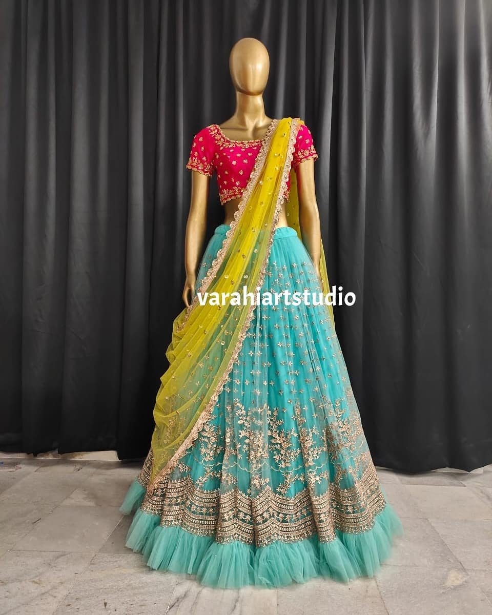 Stunning powder blue color net lehenga and pink blouse with yellow net dupatta. Blouse with hand embroidery work. 2021-07-15