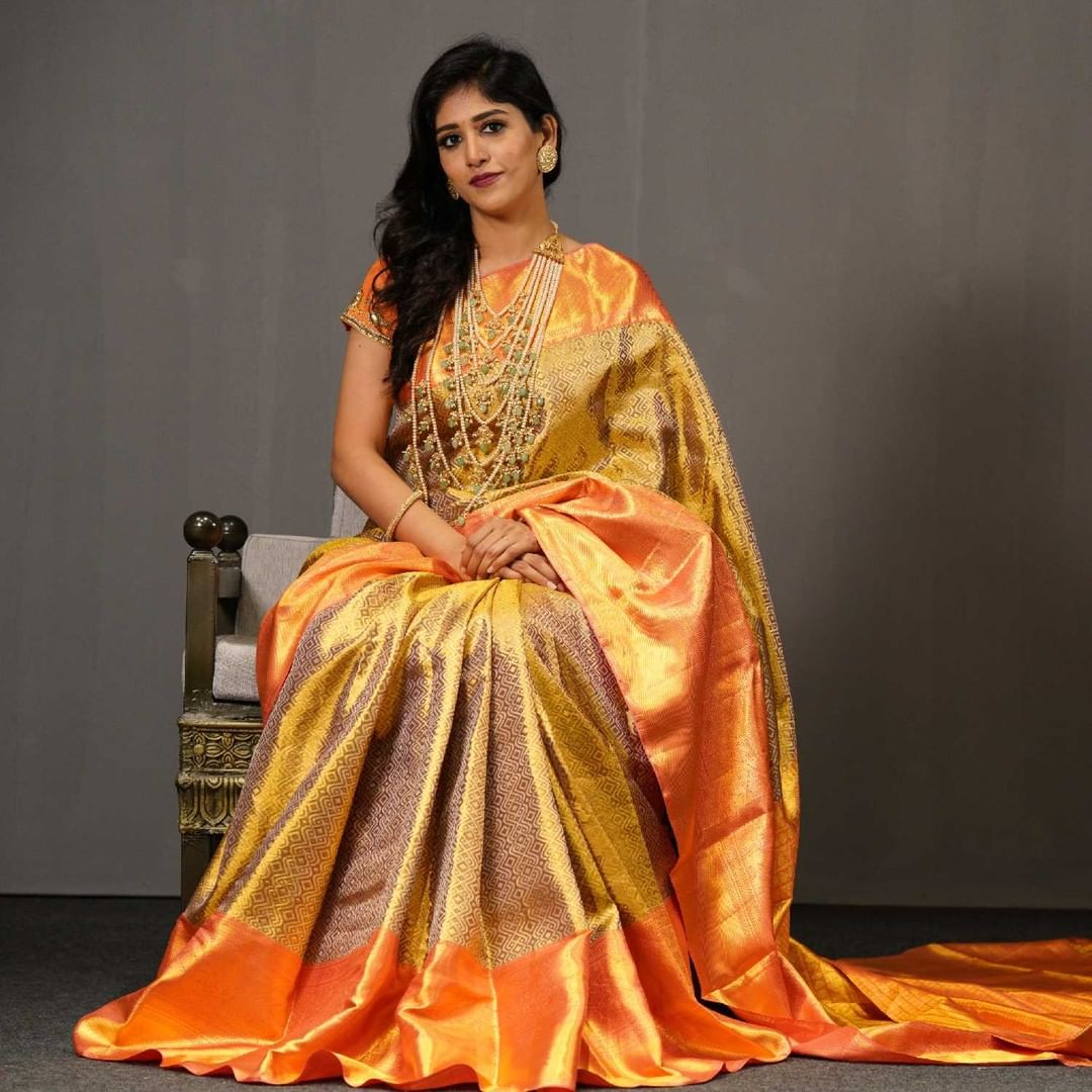Beautiful Gold Kanjeevaram saree with diamond kolam motifs interlacing the six yards in a series of connected loops  tint of orange with golden hue border adds a magnificent look on your special occasion.  Inframe: Chandini chowdary. 2021-07-15