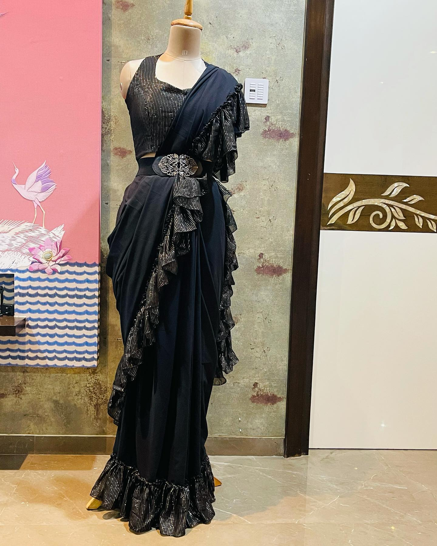 Lovely black color ruffle saree with sleeveless blouse and wasit belt. Price : 6500 INR. 2021-07-16