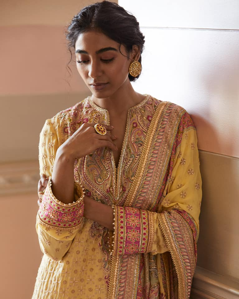 Seen here on Priti is vibrant kurta and dupatta in georgette hand embroidered with chikankari work and the studio's unique jamevar kasheeda work.  The best of craftsmanship combined with a sense of lightness 'Chikan Kasheeda' embodies the quality that our design studio holds dear - Timelessness.  2021-07-16