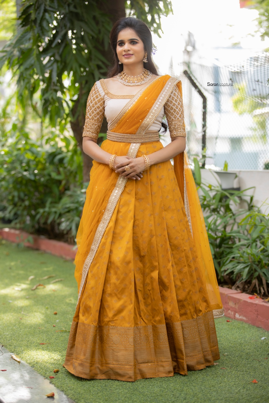 Banaras Half saree.  Mustard banarasi skirt paired with beige intricately hand embroidered blouse and net dupatta. For orders and queries  please whatsapp  on  9952093562 or Reach  on 044 4262 4085. 2021-07-16
