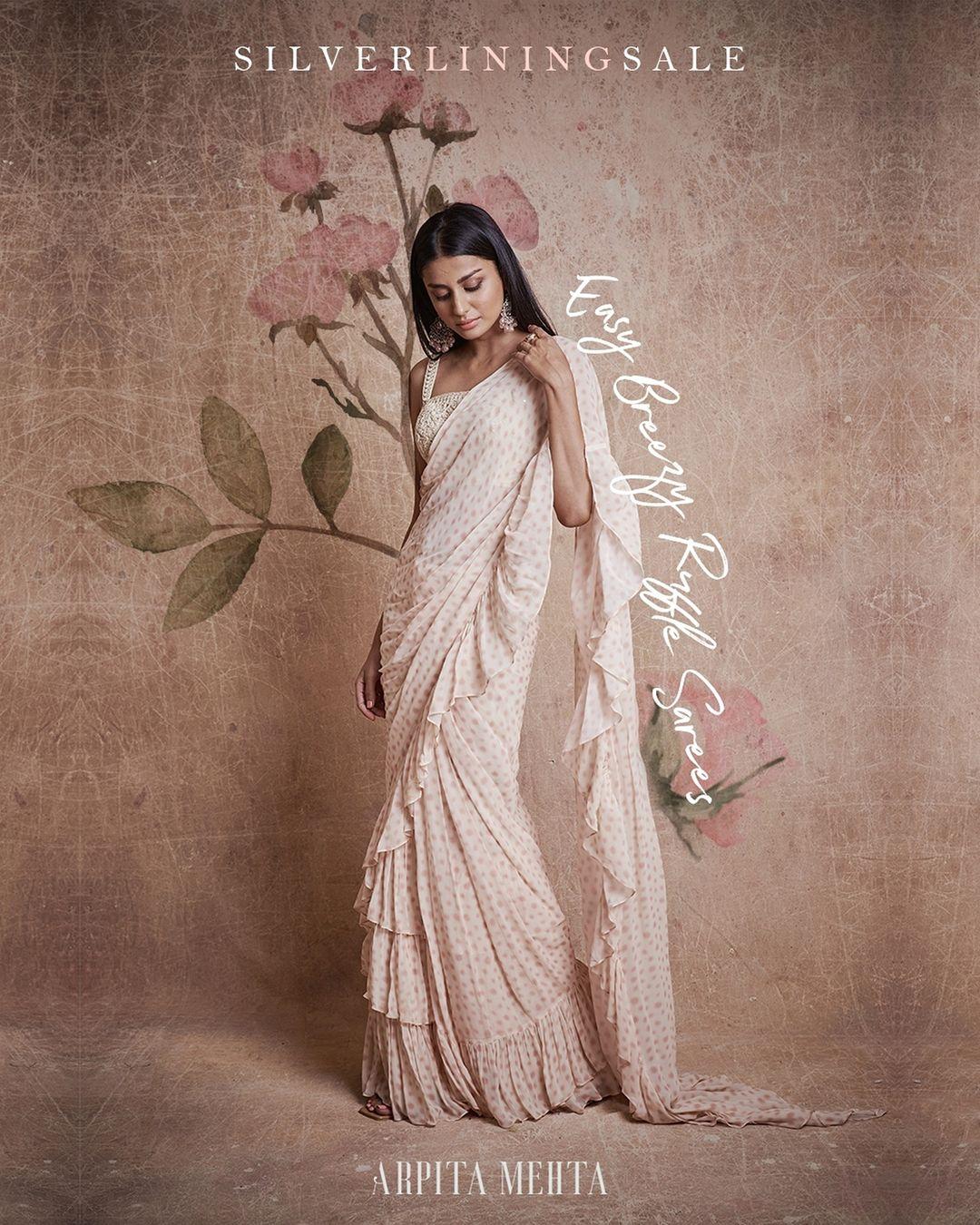 Beautiful pearl white color polka dots ruffle saree. 2021-07-16