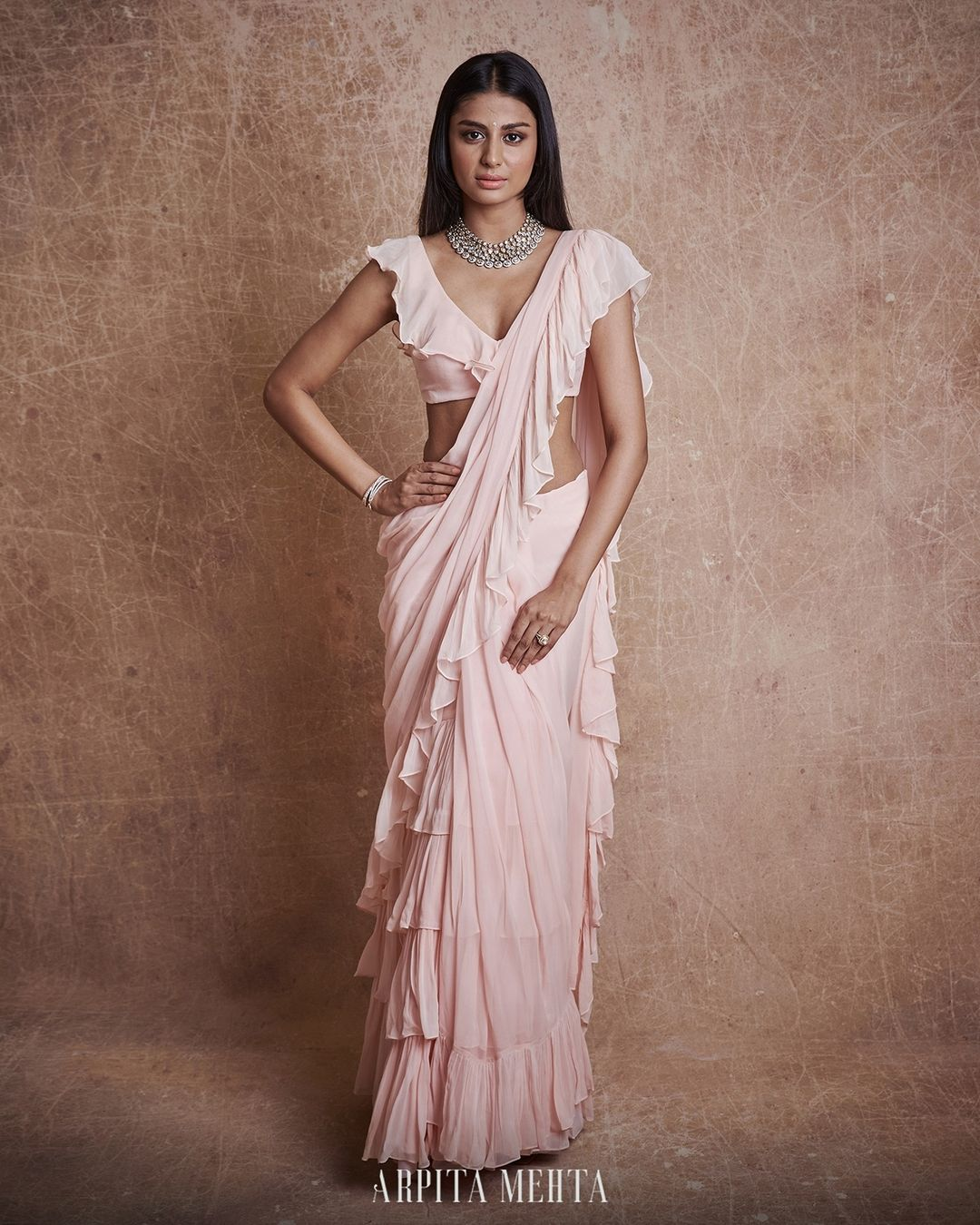 Gorgeous blush pink color ruffle saree with ruffle blouse. 2021-07-16