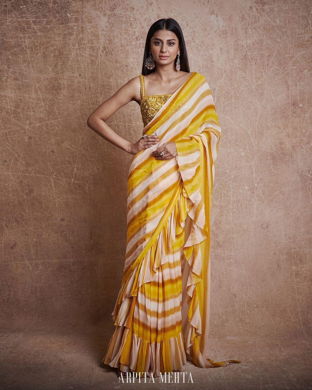 Stunning yellow striped or leheriya ruffle saree. 2021-07-16