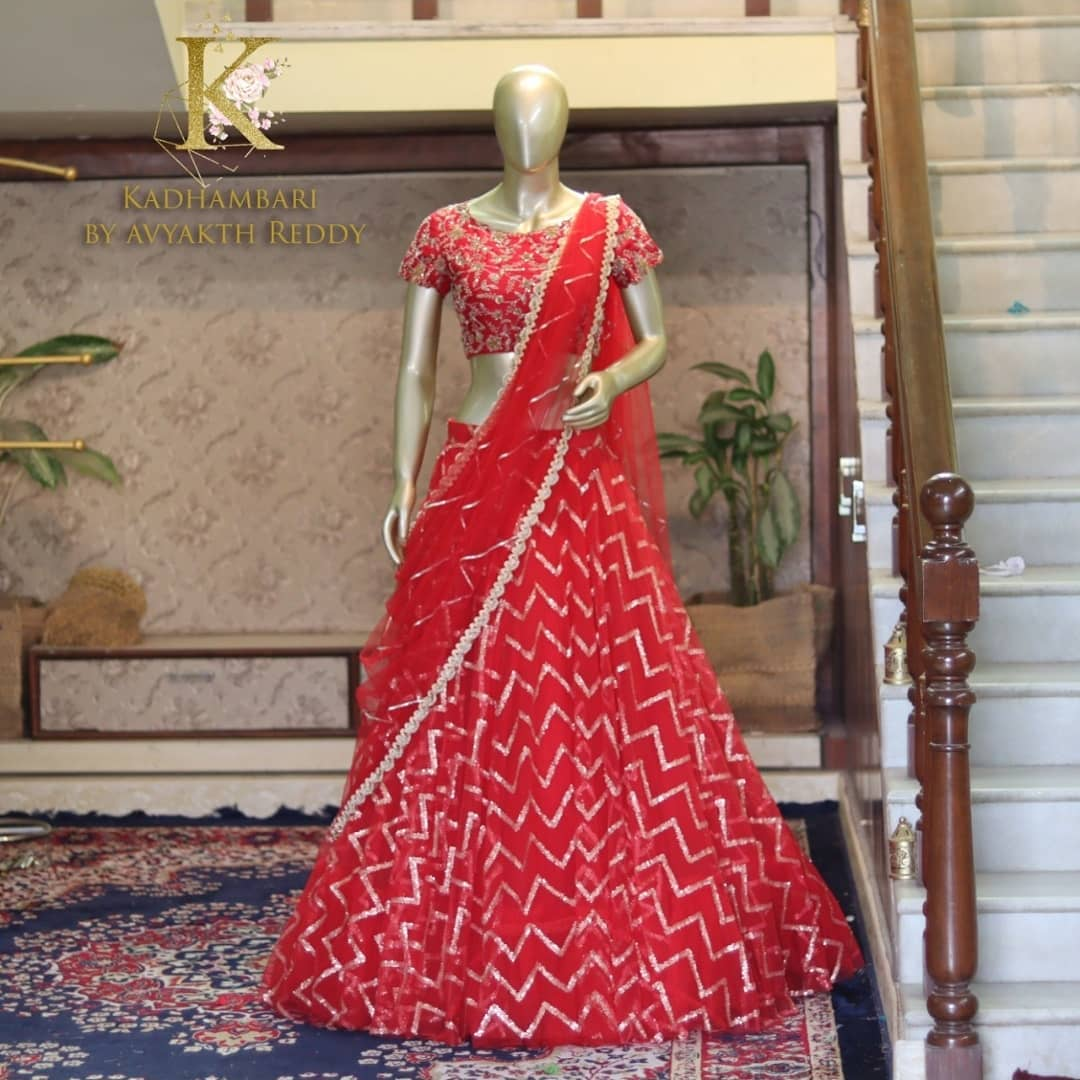 Stunning red color net bridal lehenga and blouse with net dupatta. Blouse with floral and creeper maggam work. 2021-07-16