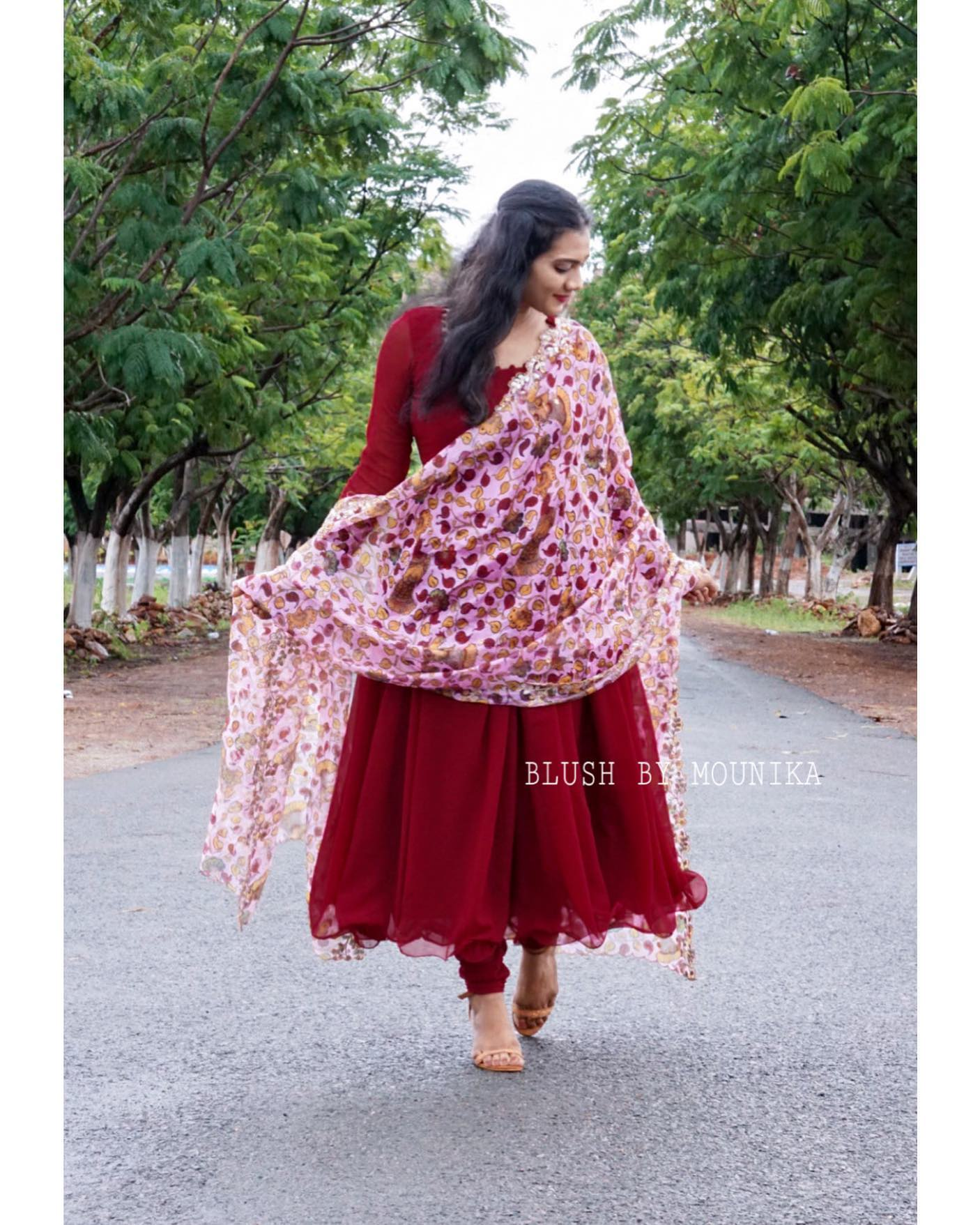 Kavyam. Price : Rs 4850/-  Deep Maroon Georggette dress and gathered pants paired with floral print organza dupatta. The dress have zari thread machine embroidery for the cuffs. 2021-07-17