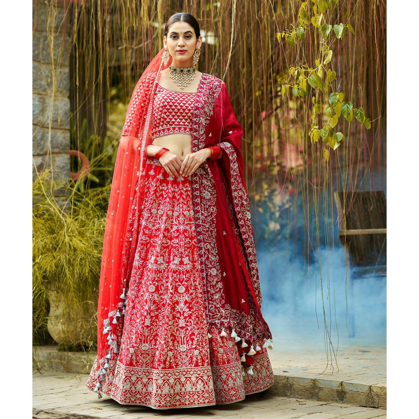Gorgeous red bridal lehenga and blouse with net melimusugu. Lehenga and blouse with hand embroidery work. 2021-07-17