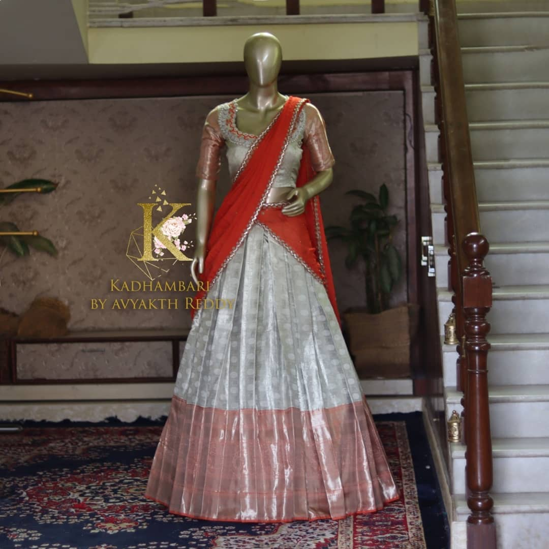 Gorgeous silver pattu lehenga and blouse with net dupatta. Blouse with embroidery work on neckline.  2021-07-18