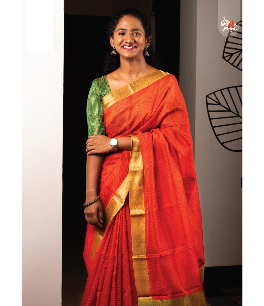 Gorgeous orange Mangalagiri cotton saree with golden zari borders paired with our green tussar zari checks readymade blouse. Simple yet elegant! 2021-07-19