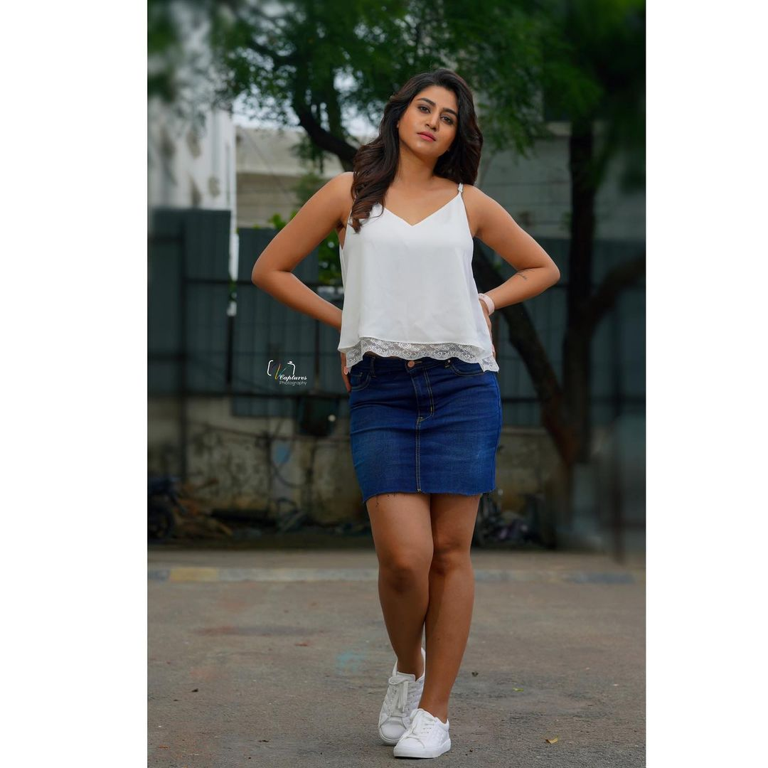 Beautiful actress and anchor Varshini Sounderajan in blue denim mini  and white top. 2021-07-19