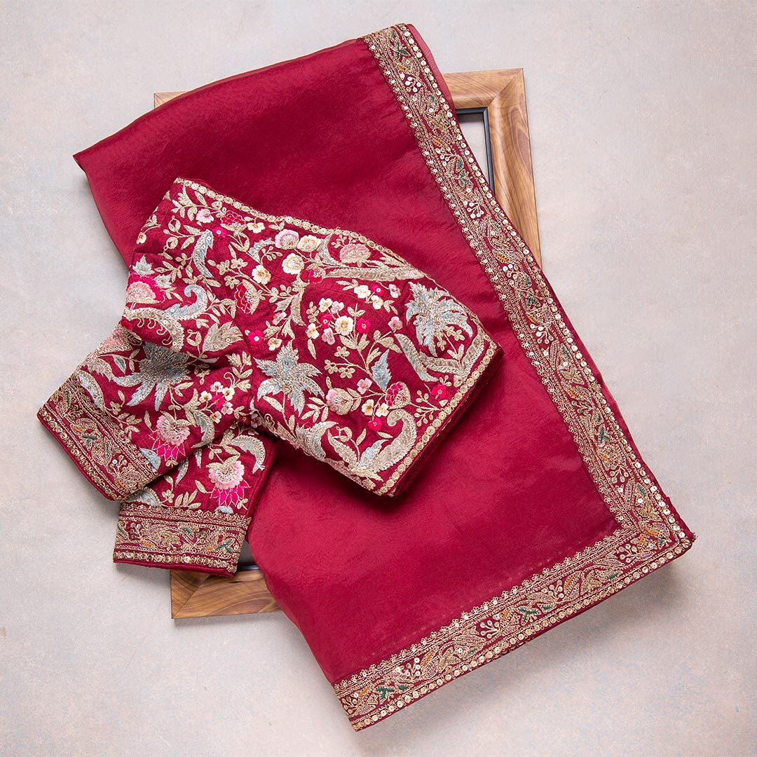 A simple and elegant red saree with enhanced gold borders is a must have! Complemented with a velvet fabricated blouse this saree is a flawless ensemble  Worldwide free shipping Contact : 00919845922959 Email: Esales@samyakk.com 2021-07-19
