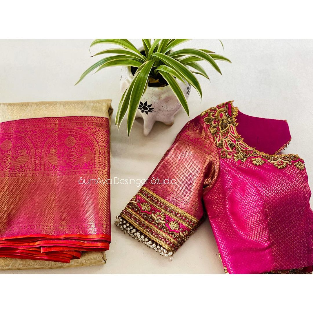 Perfectly tailored blouse is the perfect match for your six yards of beauty !  Stunning pink brocade bridal blouse with hand embroidery zardosi work.   Contact  for more details 9986455888 2021-07-19