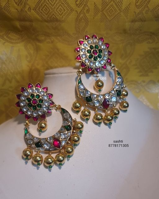 Gorgeous silver chaandbali studded with multi precious stones and gold polish. 2021-07-20