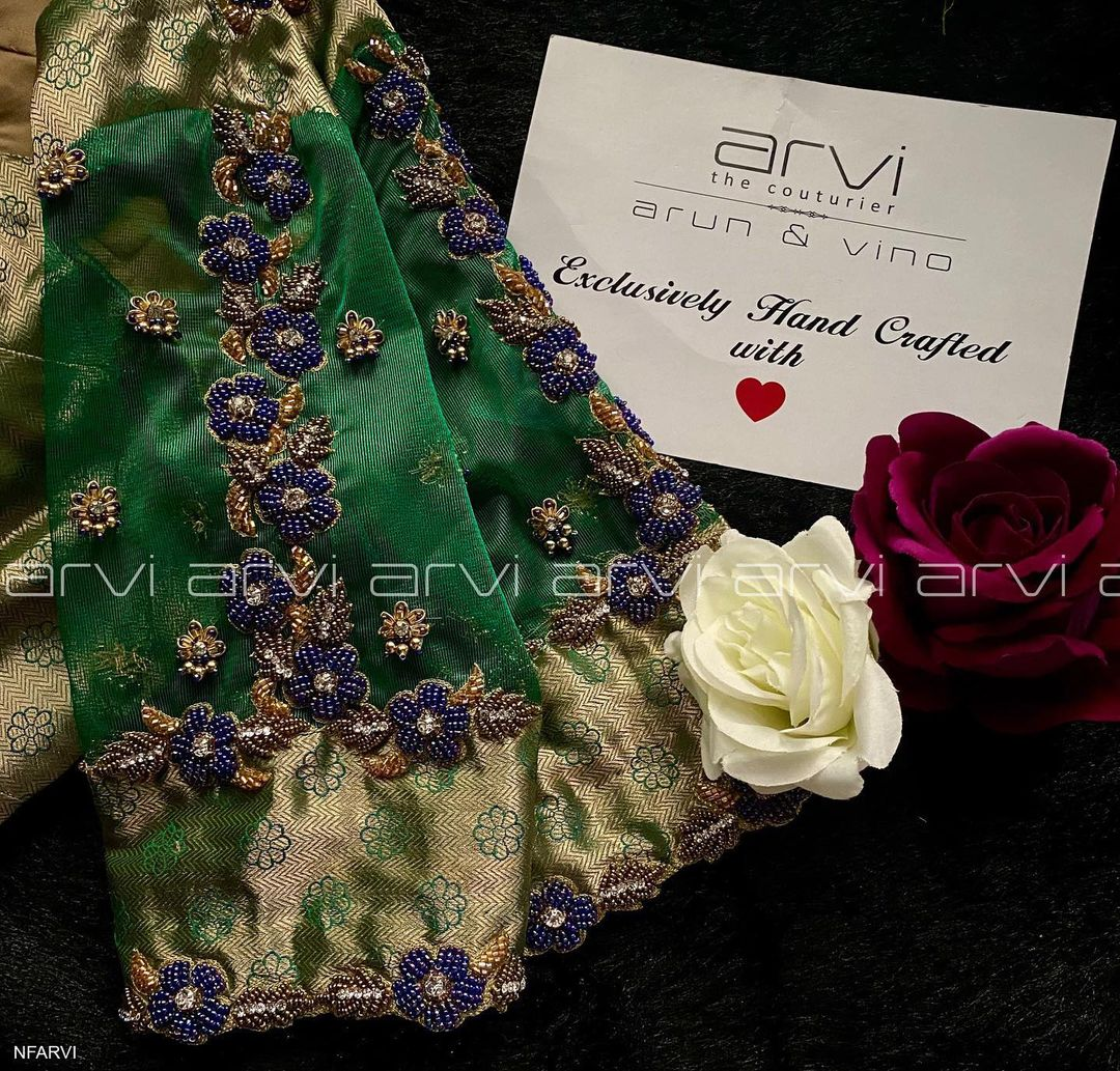 Gorgeous bridal blouse with floral creeper hand embroidery bead and gold thread aari work on sleeves.  2021-07-20