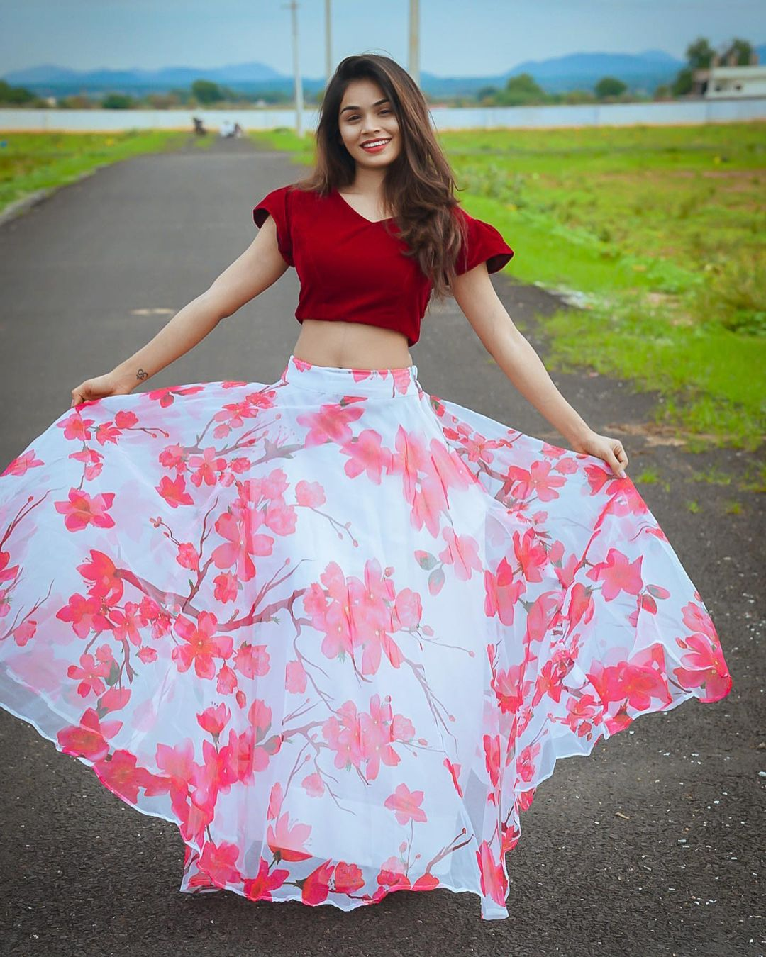 Beautiful actress Bhanuu in white floral skirt and red velvet crop top. 2021-07-20