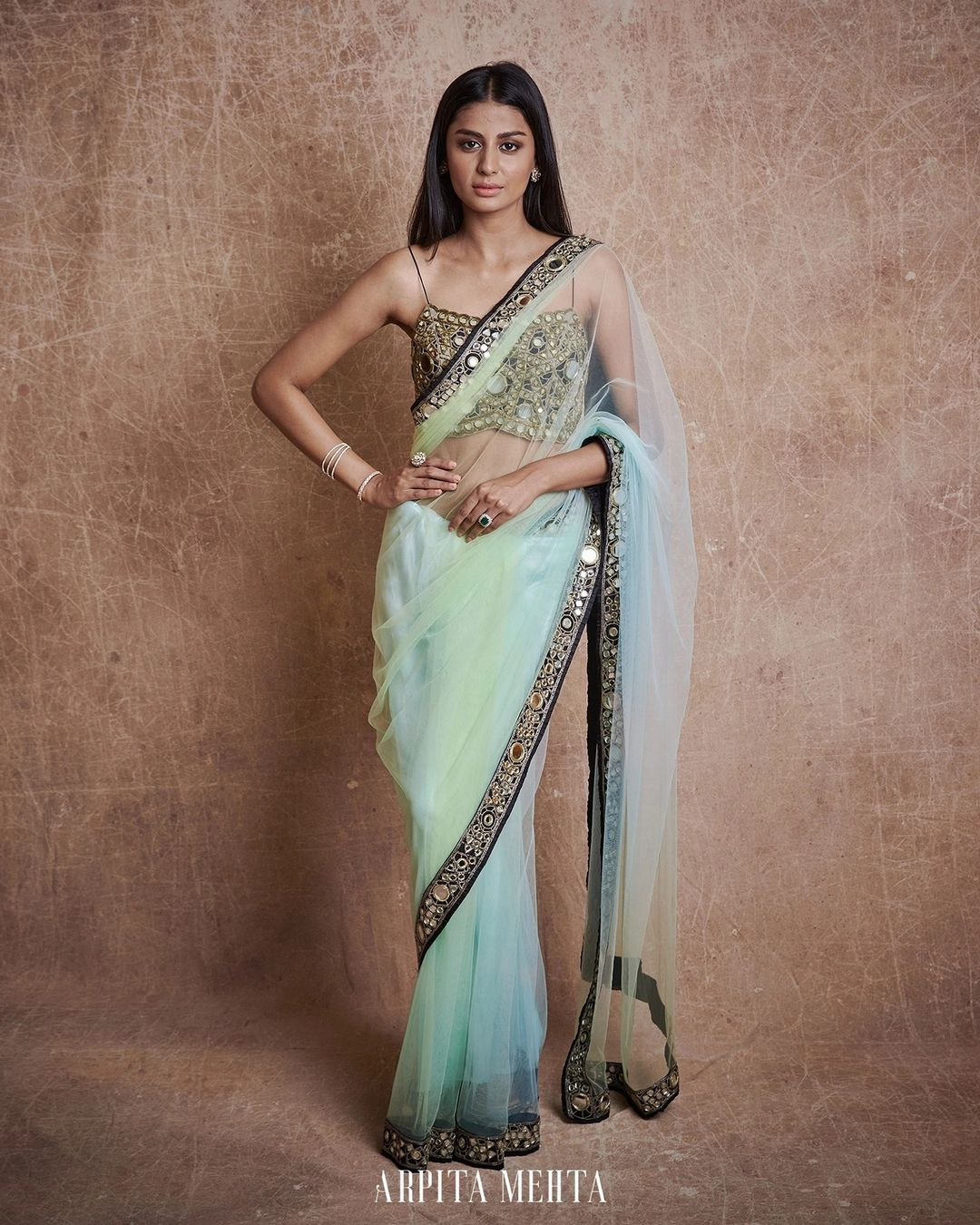 Beautiful olive green color net saree and blouse with embroidery work.  2021-07-20