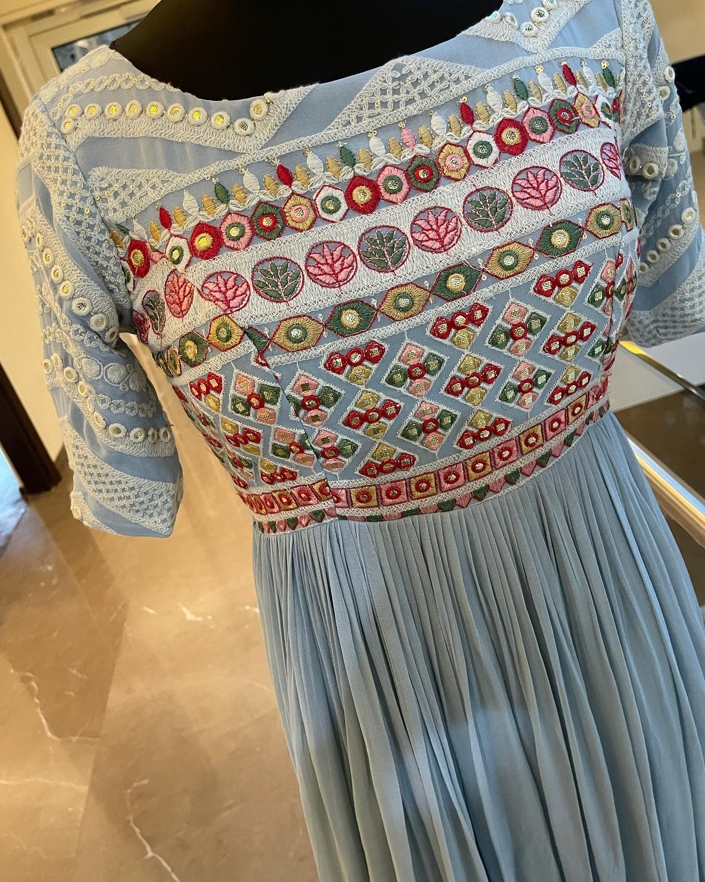 Gorgeous ice blue color Pure Georgette floor length dress with hand embroidery thread work on yoke. Price : 6000 INR.  To order WhatsApp 7013728388. 2021-07-21