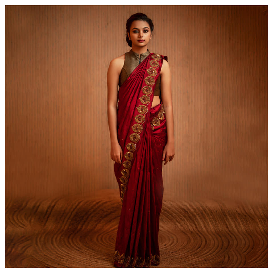 Fervent Sangria Be it a casual event or a grand gala this raw dupion silk saree is sure to be the life of the party. The rich zardosi and sequins embroidery on the border gives the attire an exquisite touch. For appointments and queries: +91-99441-33022. 2021-07-21