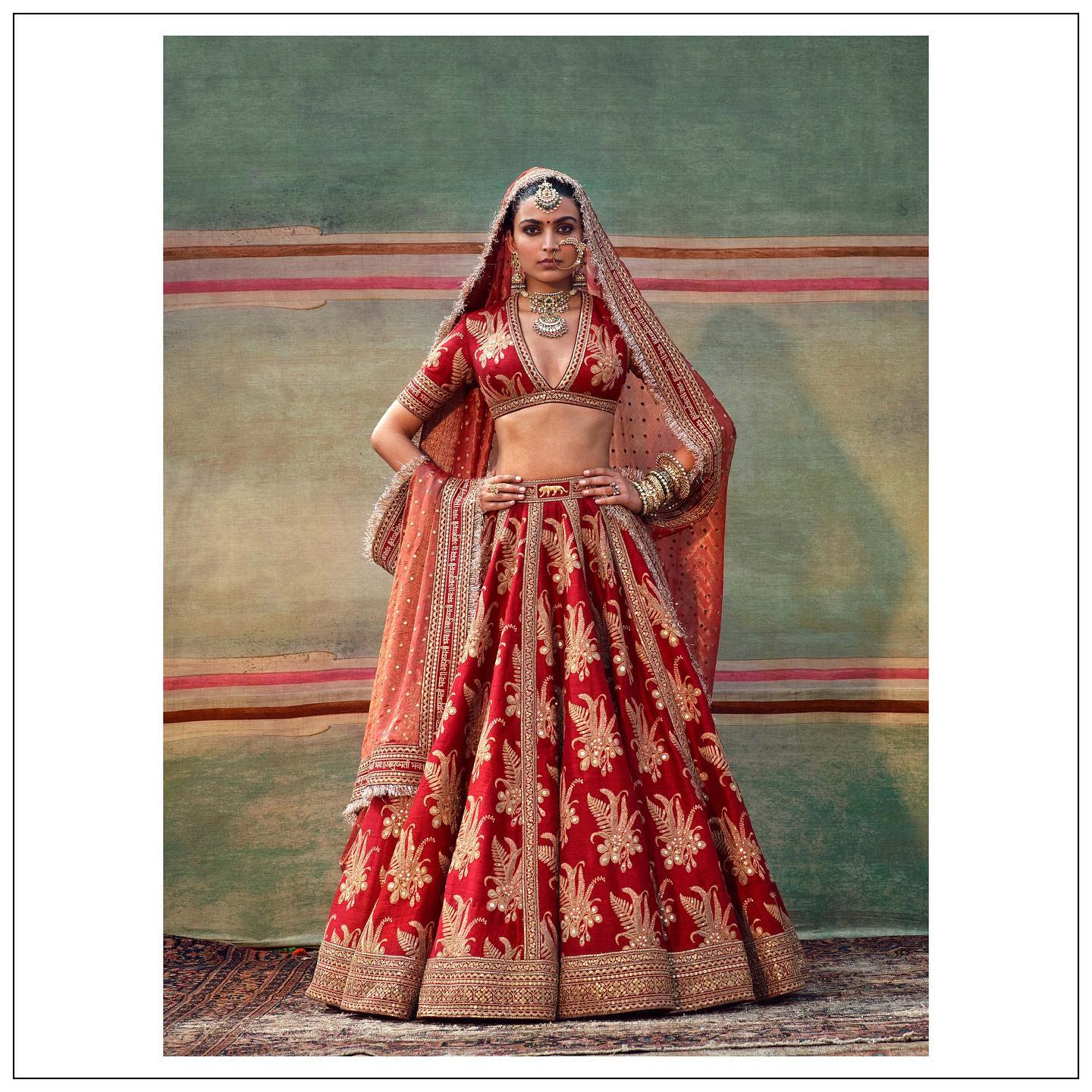 Gorgeous red color bridal lehenga and choli with dupatta. Lehenga and blouse with rich classy hand embroidery work.  For all product related queries please email  at customerservice@sabyasachi.com or contact Sabyasachi retail stores directly. 2021-07-21