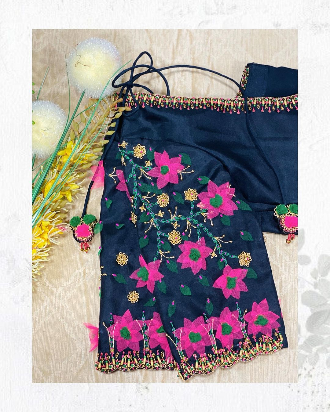 Stunning black color designer blouse with fabric floral hand embroidery work.  2021-07-21