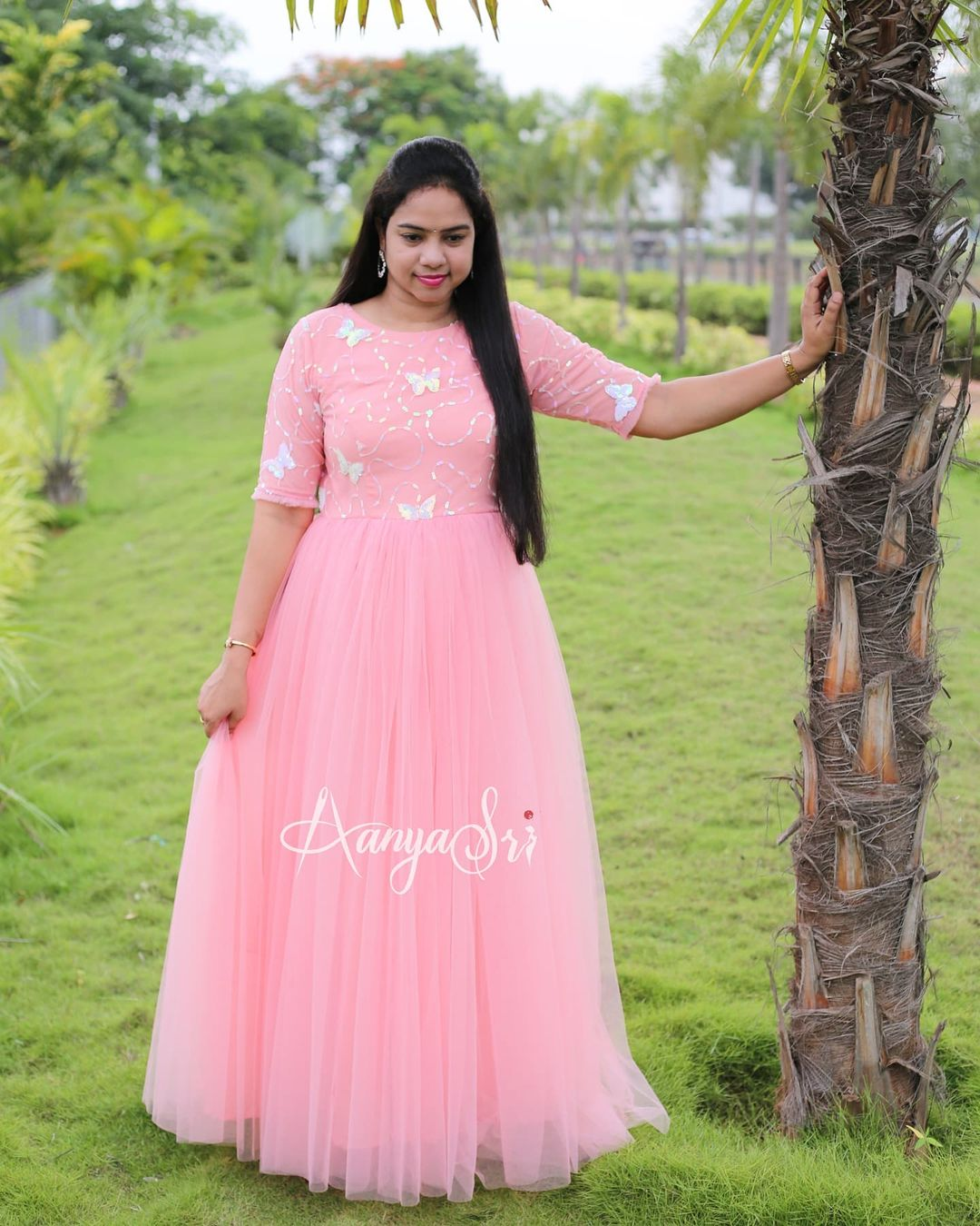 Subtle long frock with butterfly sequins work all over  can be used in two different ways !! Comes with a detachable(clip-on) butterflies skirt and completely hand embroidered pearls waistline. This is a shade between peach & pink . Price : RS. 4500. 2021-07-21