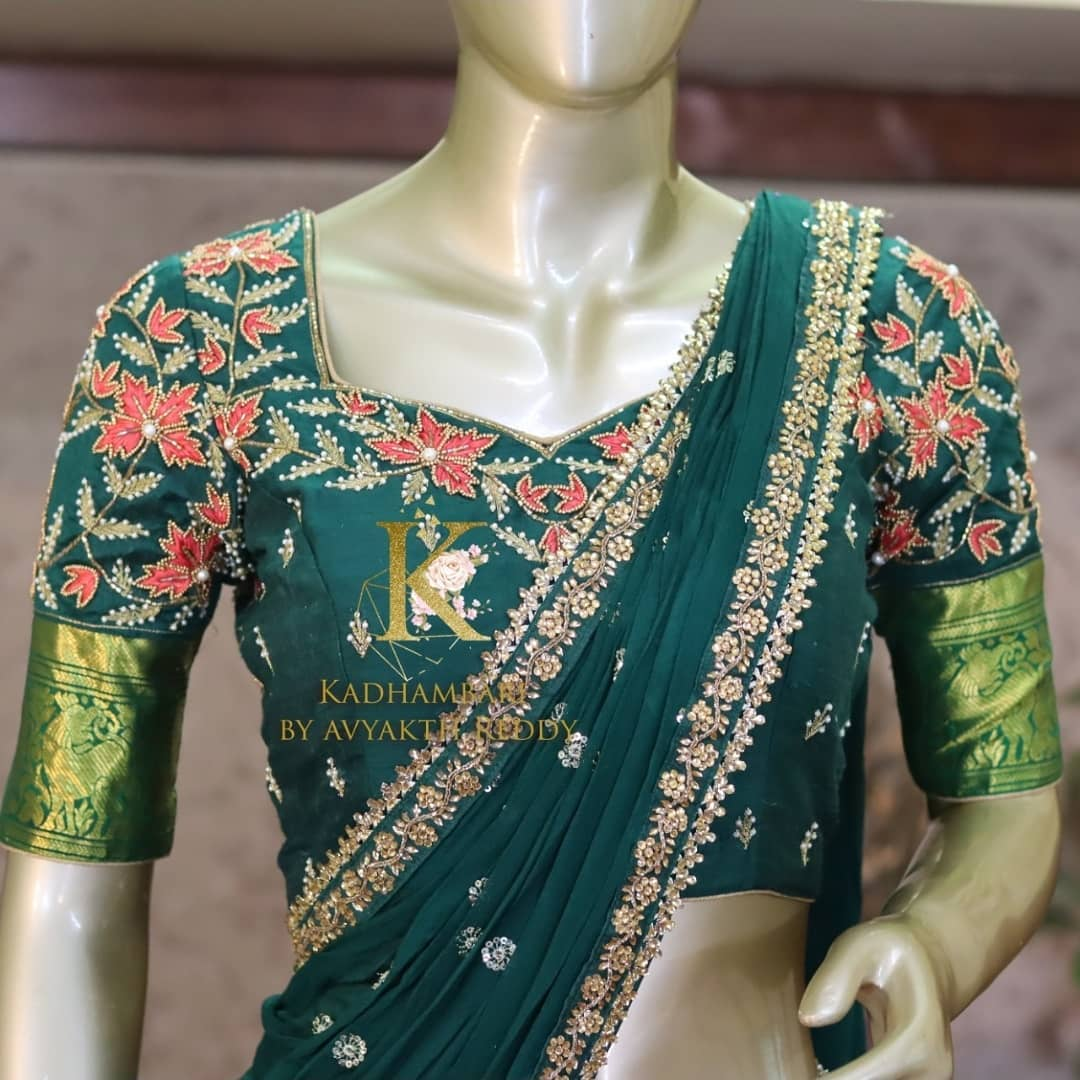 Stunning bottle green color bridal or wedding blouse with floral and leaf hand embroidery bead and stone maggam work.  2021-07-21