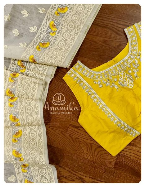 Woven on organza is this white saree with lovely yellow thread embroidered flowers. With cute little buttis all over and a border running thru the saree – this is nothing less than a WOW