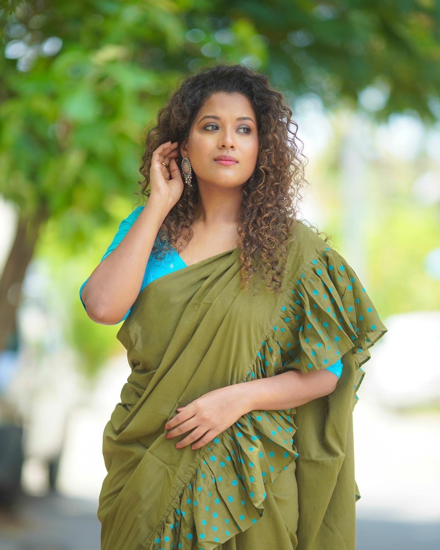 Beautiful mehandi green ruffle saree with poolka dots. 2021-07-22