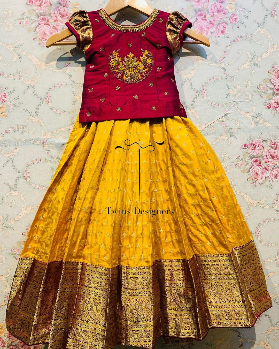 Gorgeous yellow color kids pattu lehenga and maroon kids long blouse with hand embroidery work.  2021-07-22