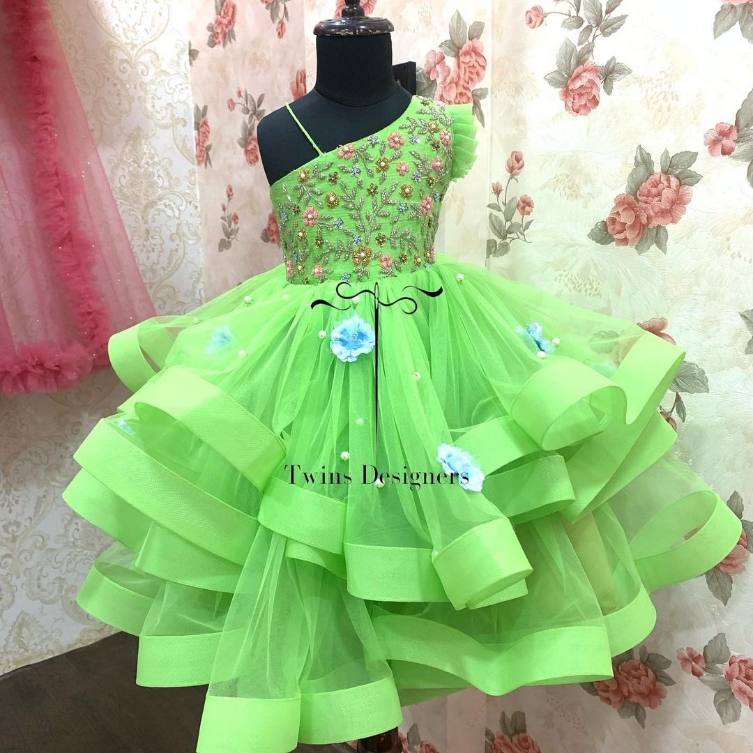 Gorgeous olive green color kids one shoulder ruffle gown with hand embroidery work on yoke.  2021-07-22