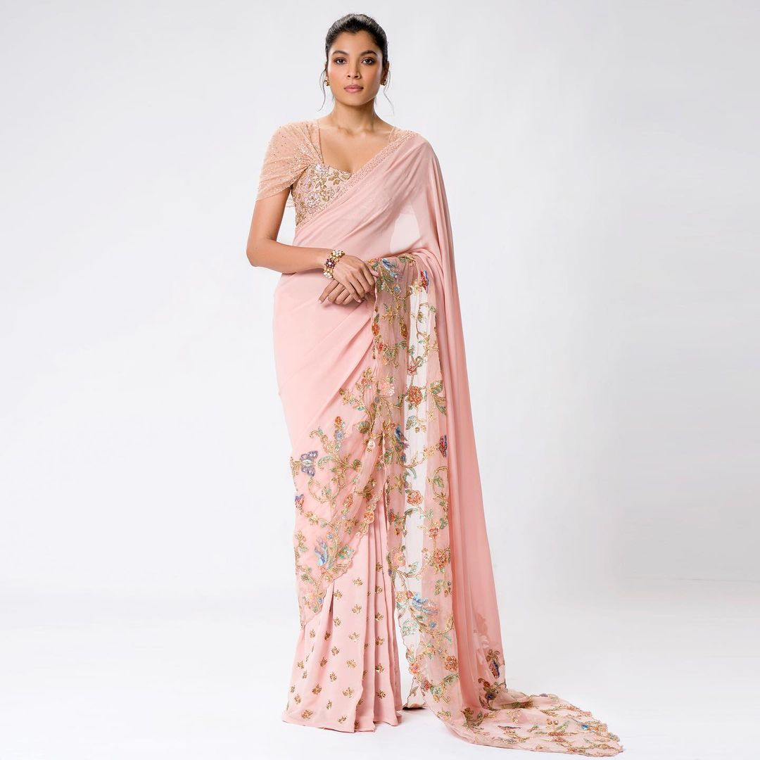A blush-pink georgette saree embroidered with floral and bird motifs in zardosi and sequins. . Kindly WhatsApp  on +91-9833520520 for more information. 2021-07-22