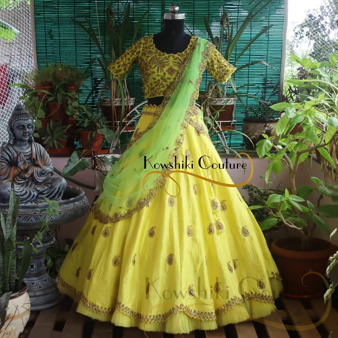 Gorgeous heavy work Yellow Lehenga choli with parrot green duppatta makes excellent selection for your Reception. 2021-07-22