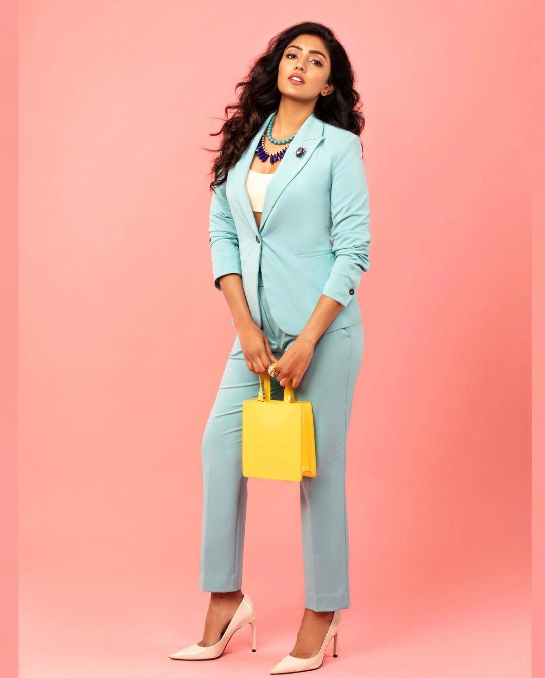 Stunning actress Eesha Reba in sky blue color pants and blazer with yellow hand bag. 2021-07-22