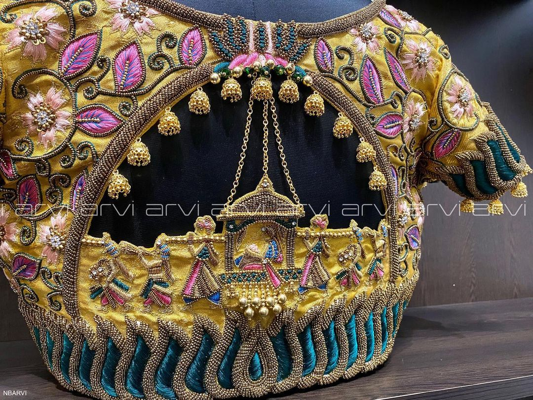Stunning yellow color bridal or wedding blouse with pallki hand embroidery heavy maggam work.  2021-07-22
