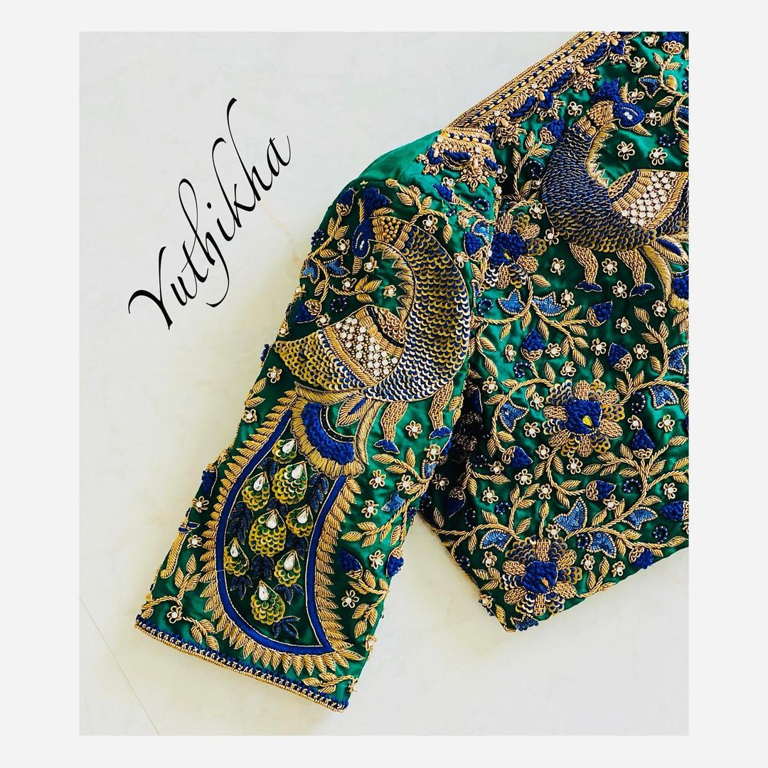 Stunning bottle green color bridal blouse with creeper and peacock hand embroidery heavy maggam work.  2021-07-22