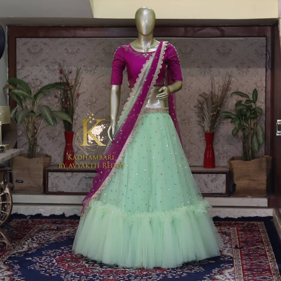 Stunning sea green color bridal net lehenga and purple blouse with net dupatta. This outfit is Available at Rs 11800/-  2021-07-22