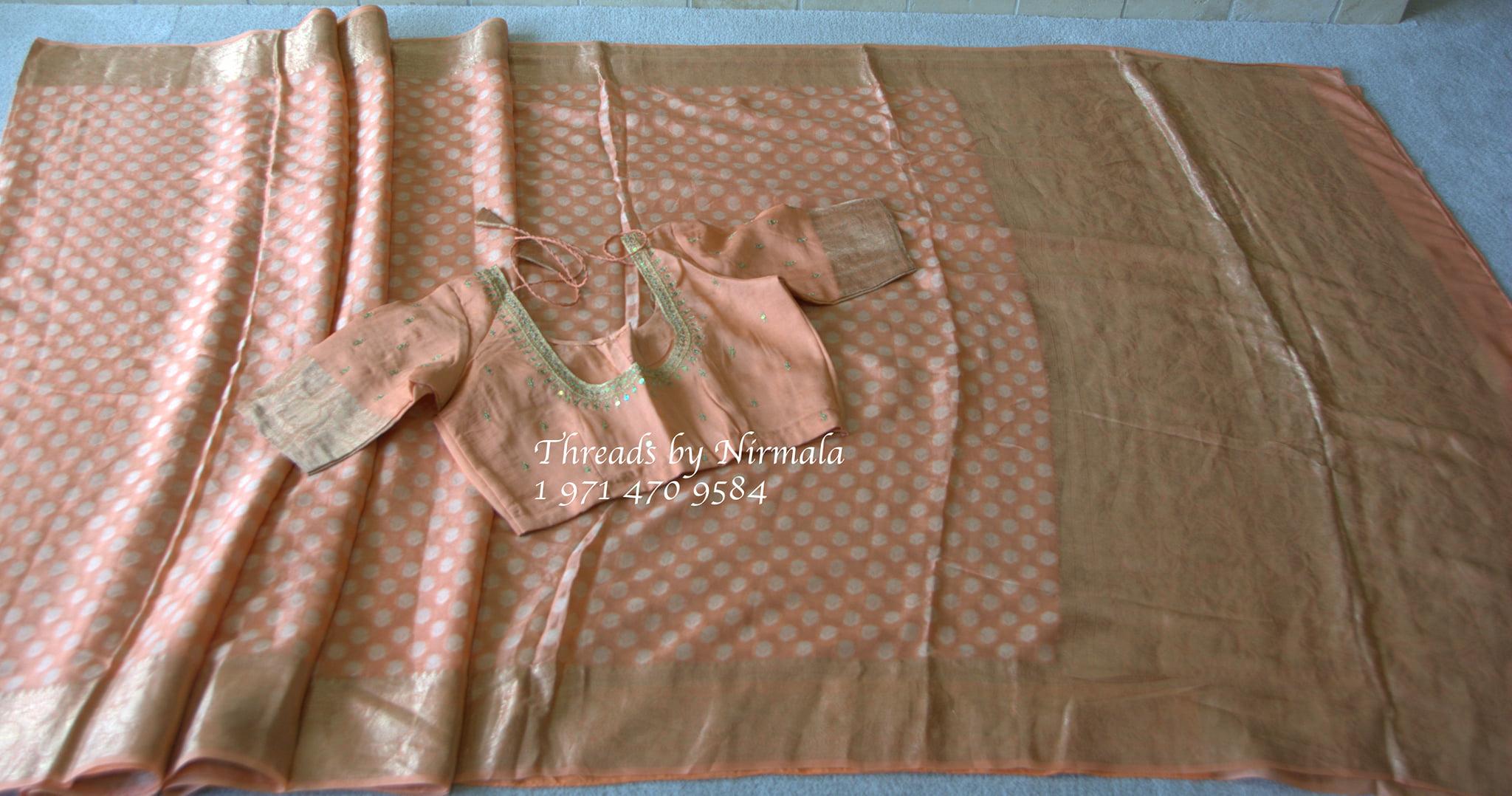 A lovely peach lightweight Benaras gerogette saree with a maggam work blouse. 2021-07-23