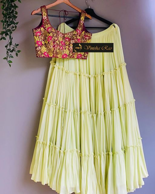 Pastel yellow layered lehenga teamed with burgundy shade pure raw silk blouse with heavy hand embroidery work on front and back which is perfect for mehendi party .  Suitable for all kind of occasions !! .. . You can call  to order on Contact : 9704994151. . Email - shopvinisharao@gmail.com 2021-07-23