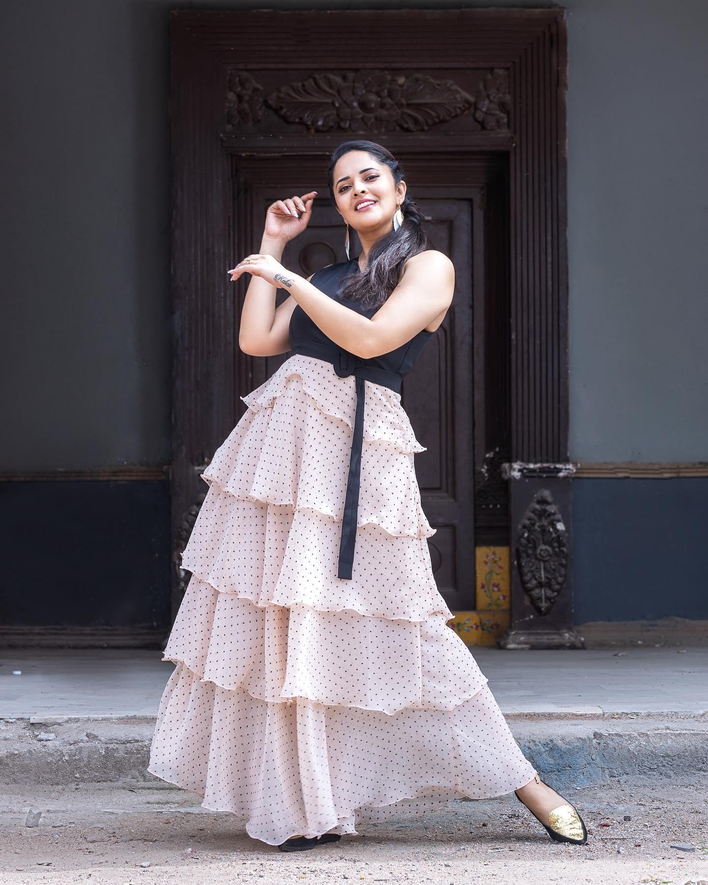 Gorgeous actress Anasuya Bardwaj in one shoulder polka dots ruffle dress. 2021-07-23