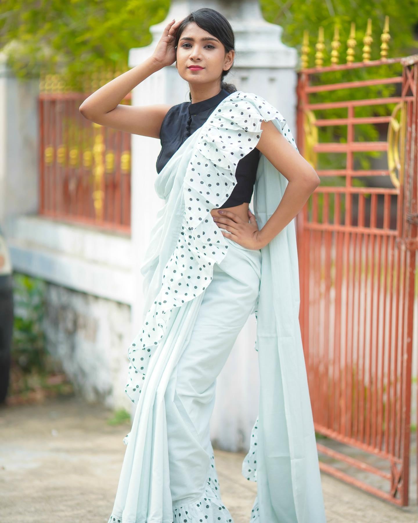 Stunning ice blue color polka dots ruffle saree. 2021-07-24